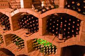 stacked bottles inside a wine cellar