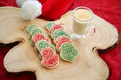 Christmas Cookies with Eggnog.  Christmas Tree out of focus in the background with cookies and Eggno poster