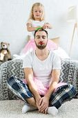 Adorable Little Daughter In Pink Tutu Skirt Doing Hairstyle To Father With Red Lipstick poster