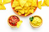 Snack For Party. Mexican Nachos Near Salsa And Guacamole Sause On White Background Top View poster
