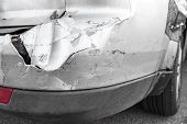 Silver Car With Rear Part Damaged In Crash Accident Or Collision With Scratched Paint And Dented Rea poster