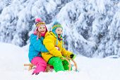 Kids Play In Snow. Winter Sled Ride For Children poster
