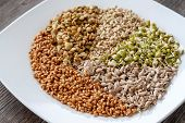 Vegetarianism. A Set Of Different Sprouted Seeds For Healthy Eating On A White Plate. Sprouted Seeds poster
