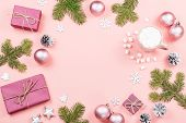 Christmas Background With Fir Branches, Lights, Purple Giftboxes, Pink Decorations, Hot Drink With M poster