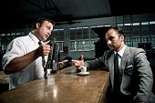 Waiter offers man a refill of fresh coffee from the pot