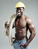 Happy builder construction worker man with rope and hard hat
