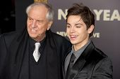 HOLLYWOOD, CA - DECEMBER 5: Director Garry Marshall and actor Jake T. Austin arrive at the premiere