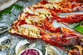 Beautiful Tasty Lobsters On Ice Ready To Eat. Seafood Large Lobsters, Some Oysters On Ice In A Resta poster