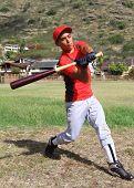 Baseball player mid-swing