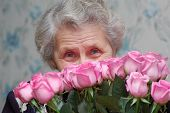 Happy Granny Behind Bouquet Of Pink Rose