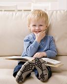 Young boy enjoying reading a book