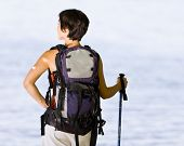 Woman hiking with backpack and walking stick