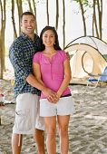 Couple holding hands at campsite