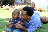 stock photo of middle class  - African American family together outside their home - JPG