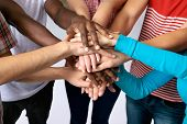 stock photo of japan girl  - Team of friends showing unity with their hands together - JPG