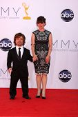 LOS ANGELES - SEP 23:  Peter Dinklage; Erica Schmidt arrives at the 2012 Emmy Awards at Nokia Theate
