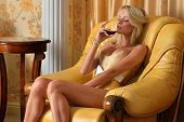 Beautiful Undressed Woman With Glasss O Red Wine In Luxury Interior.