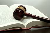 picture of court hammer  - wooden gavel and book on wooden table - JPG