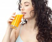 head and shoulders portrait of attractive  caucasian  woman isolated on white studio shot drinking orange juice face skin