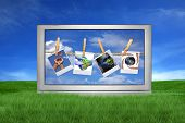 foto of high-def  - Large Screen Television Isolated Outdoors With Global Issue Concepts Hanging on Film Blanks - JPG