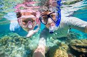 Underwater photo of a couple snorkeling in ocean