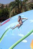 Girl Sliding On Wet Bubble Game Pool