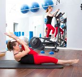 Aerobics pilates gym women group with cross trainer