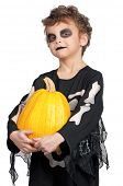 stock photo of antichrist  - Portrait of little boy wearing halloween costume with pumpkin on white background - JPG