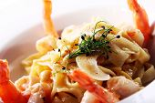 Fresh italian seafood pasta served with shrimps