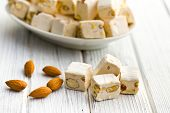 white nougat with almonds on wooden table