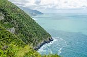Majestic mountain ocean view from famous trail between Monterosso and Vernazza, Italy.