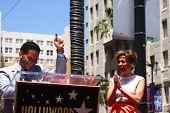 LOS ANGELES - JUN 20:  Benny Medina, Jennifer Lopez at the Hollywood Walk of Fame star ceremony for