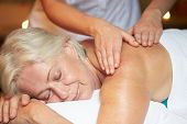 Senior Woman Having Massage im Spa