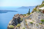 Traditional Sights Of Colorful Ladder And Caldera Sea In Background