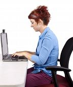 foto of scoliosis  - young woman demonstrating proper office desk posture - JPG