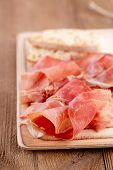 Platter of serrano jamon Cured Meat and ciabatta
