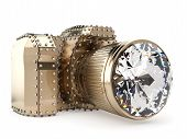 golden photo camera with diamond lens