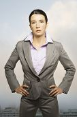 Portrait of businesswoman standing with hands on hips