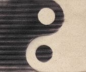 Yin-yang Symbol  On The Sand