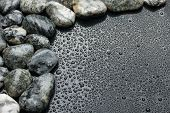 Gray Stones Lie On The Background Of Water Droplets