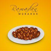 Muslim community festival Ramadan Mubarak background with fresh dates for Iftar food.