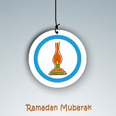 Holy month of Muslim community Ramadan Kareem background with illuminated tradition lantern on hanging tag or label.