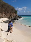 Couple Standing On Frys Beach In Antigua Barbuda