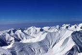 View On Off-piste Slopes And Multicolor Blue Sky At Nice Sunny Day