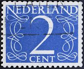 Dutch Postage stamp - isolated on black.