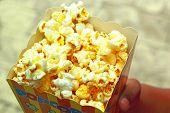 Child Holding Popcorn
