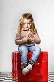 Cute Little Girl Posing In Studio