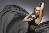 foto of up-skirt  - creative portrait of fashion bizarre woman with strong gothic make - JPG