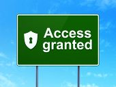 Privacy concept: Access Granted and Shield With Keyhole on road sign background