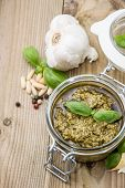 pic of pesto sauce  - Homemade Pesto Sauce with ingredients on wooden background - JPG